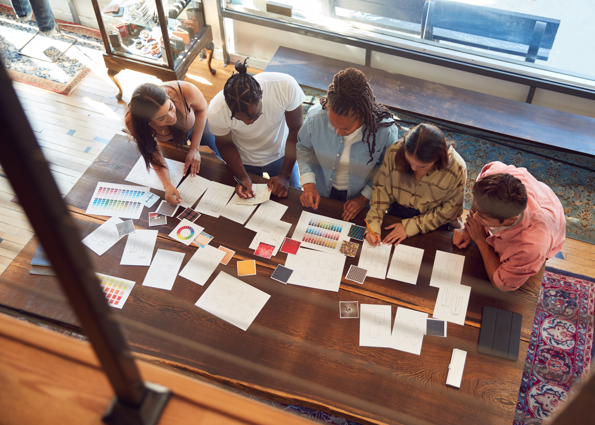 people-gathered-around-a-table-with-notes-and-papers